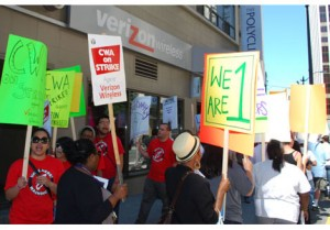 Dozens of supporters of Verizon strikers picket in downtown Seattle on Aug. 19, 2011.
