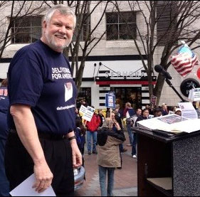 Bob James, President of the Washington Association of Letter Carriers (and WSLC Vice President), prepares to address the Seattle crowd March 24.