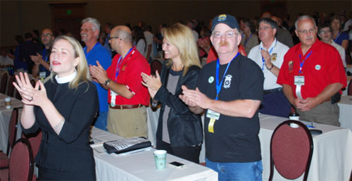 "Lily Wilson-Codega of Teamsters Joint Council 28 (center, between the guys with a red shirt and the baseball cap) apparently thinks the new lyrics to ""Come Together"" are pretty dang funny."