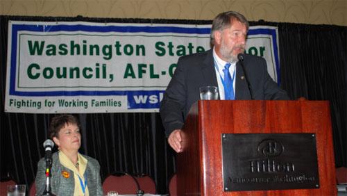 WSLC President Jeff Johnson delivers his opening remarks Thursday as WSLC Secretary-Treasurer Lynne Dodson looks on.