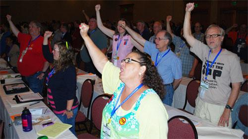 Delegates sing along.