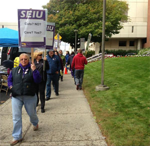 SEIU HealthCare 1199NW conduct an information picket outside Deaconess Hospital in October.