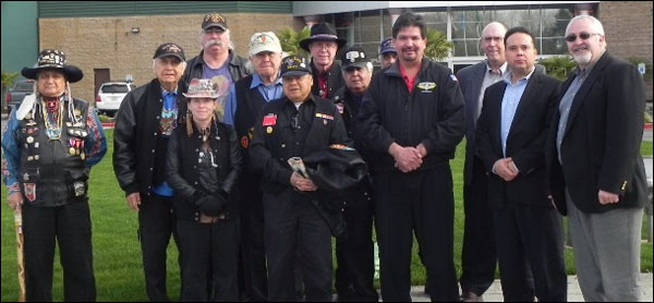 At a gathering of the Inter Tribal Warriors Society in Washington state, General Vice President Gary Allen, second from right, presented a donation to the Council for First Inhabitants Rights and Equality (Council FIRE), an advocacy group for Native American issues founded by Western Territory Grand Lodge Representative Kevin Cummings, right.