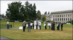 "Freedom Foundation staffers ""rally"" last week in Olympia to make state employee contract negotiations public."
