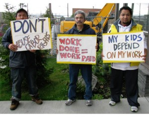 (From left) Armando Arredondo, Hector Martinez and Noe Montes of the Workers defense Committee at Casa Latina.